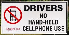 handheld cell phone driving outlawed billboard