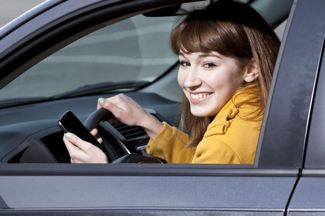Teenager with iPhone driving distracted