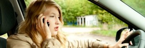 Woman engaged in distracted driving with cell phone